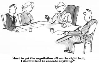 attorney with clients at a negotiations meeting